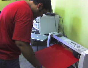 Me working on the plotter